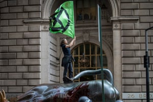 """More than 20 members of the group were arrested after staging a """"Die In"""" and covering the famed brass bull in fake blood. The group covered the English Treasury building in fake blood, too, last week."""
