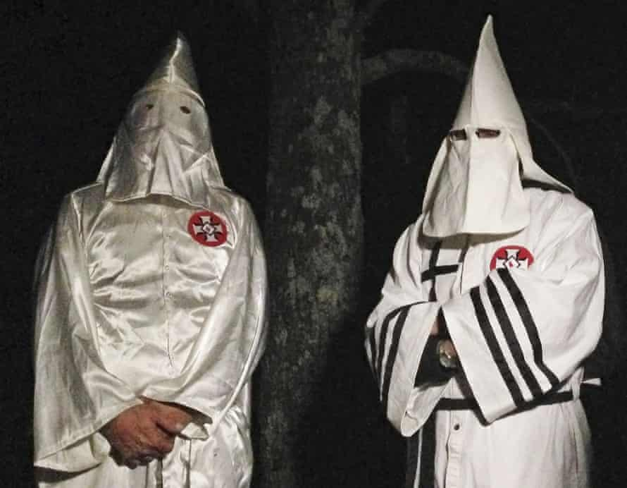 Two masked Ku Klux Klansmen giving an interview to the Associated Press near Pelham, North Carolina on the night of 2 December.