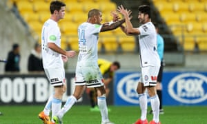Connor Chapman (left) and Paulo Retre (right) of Melbourne City celebrate a win with Patrick Kisnorbo on May 3, 2015 in Wellington, New Zealand.