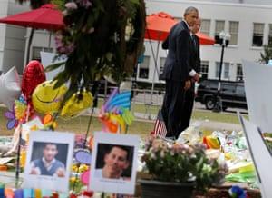 Barack Obama and Joe Biden pause at a makeshift memorial for the Orlando shooting victims.