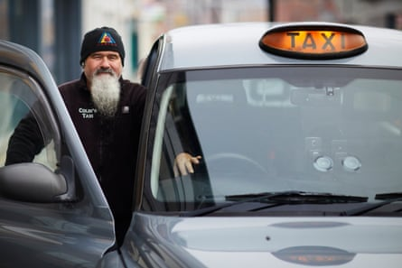 Colin Turnbull with his taxi. He says he will not ask passengers where they are from because 'that's not our job. We aren't the police.'