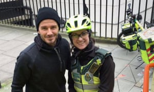 Beckham with Maynard in a photo tweeted by the London Ambulance Service.