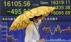An electronic board shows steep falls on the markets in Tokyo on Monday.