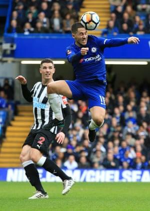 Eden Hazard beats Ciaran Clark to the header.