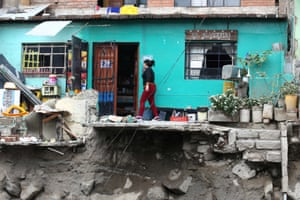 A woman outside her house following a landslide and floods in Chosica, Peru