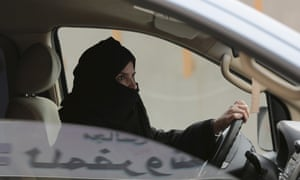 One of the released activists, Aziza al-Yousef, drives a car in Riyadh as part of a campaign to defy Saudi Arabia's then ban on women driving.