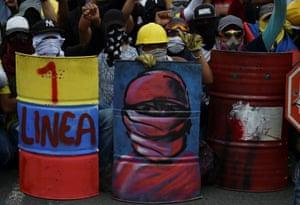 Demonstrators hold homemade shields in Cali
