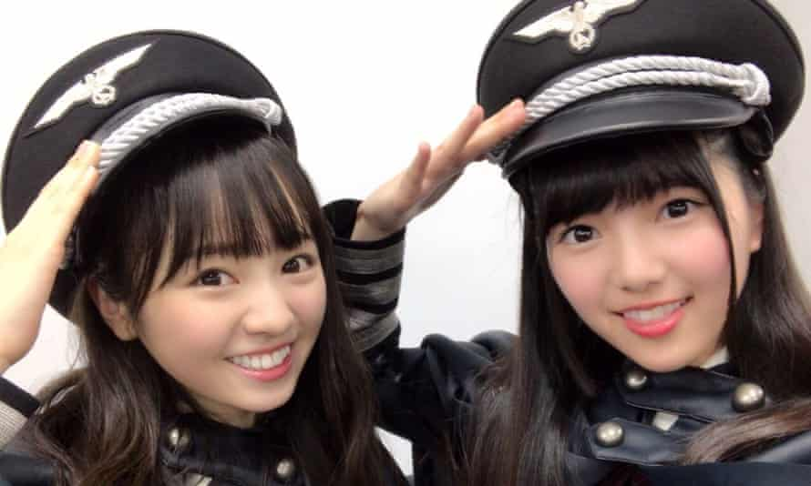 Members of Keyakizaka46 wearing Nazi-style uniforms for their Perfect Halloween concert
