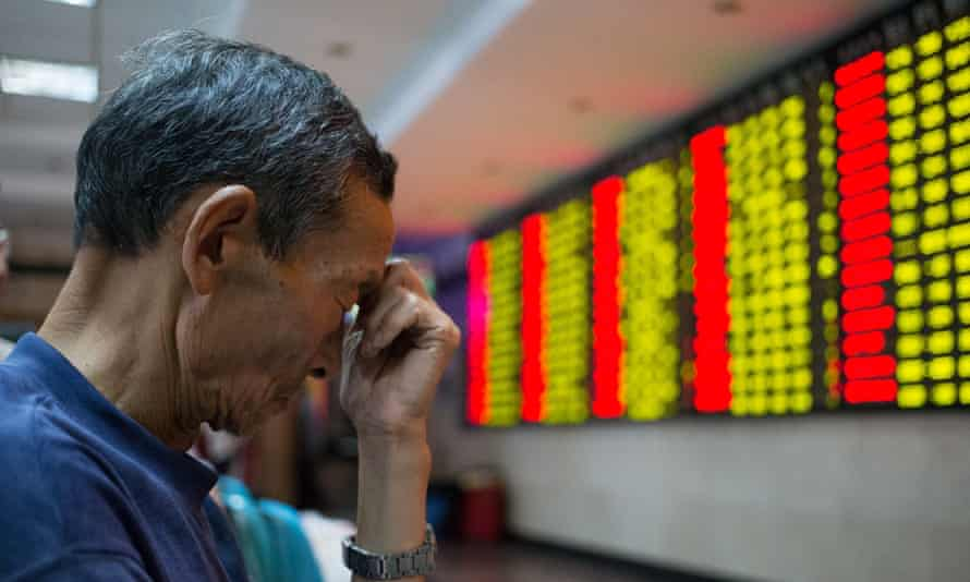 A Chinese investor reacts to a slump in share prices.