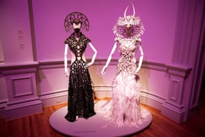 """""""Nagana Brass Gown"""" (L) by Gelareh Alam and """"The Crown of Nagini"""" (R) by Caley Johnson are seen during a preview of the No Spectators: The Art of Burning Man exhibition at the Renwick Gallery in Washington, DC on March 29, 2018. The show brings artwork from the Nevada desert gathering to Washington for the first time. The exhibition runs from March 30, 2018 to January 21, 2019. / AFP PHOTO / Mandel NGAN / RESTRICTED TO EDITORIAL USE - MANDATORY MENTION OF THE ARTIST UPON PUBLICATION - TO ILLUSTRATE THE EVENT AS SPECIFIED IN THE CAPTIONMANDEL NGAN/AFP/Getty Images"""