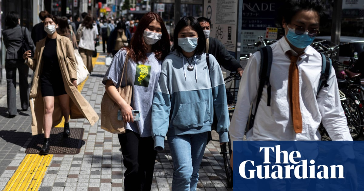 Japan to declare targeted state of emergency as Covid cases surge