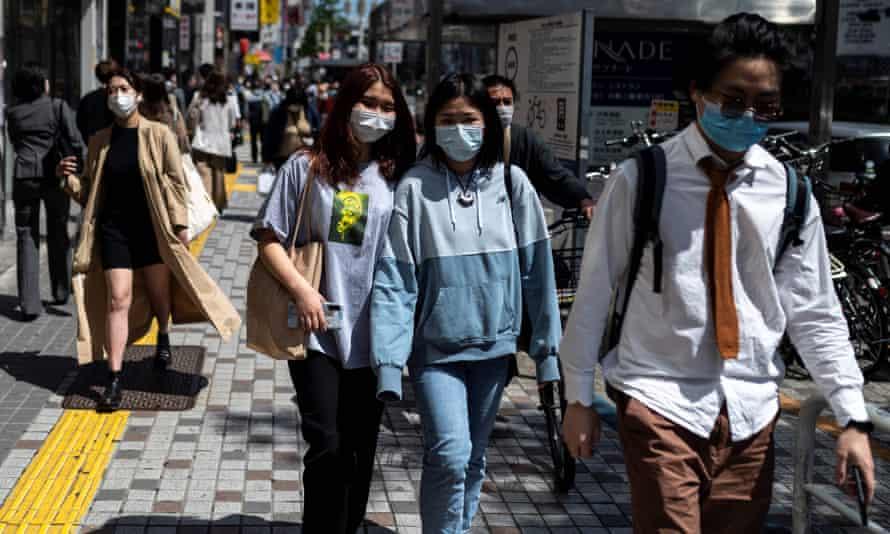 Pedestrians in Tokyo's Shinjuku are