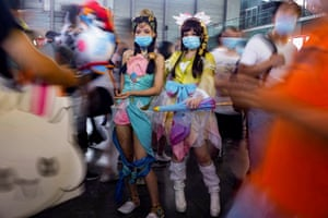 Shanghai, China: Cosplay fans wearing face masks attend the ChinaJoy Expo
