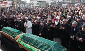 Mourners attend a memorial service for victims of the racist terror attack in Hanau, Germany, 28 February 2020.