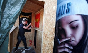 A Christiania resident demolishes a cannabis stall following the shooting.