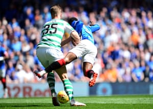 Defoe, tackled by Ajer.