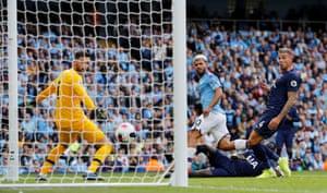 Manchester City's Sergio Aguero scores their second goal .