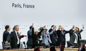 World leaders celebrate the adoption of a climate agreement during the Paris talks earlier this month.