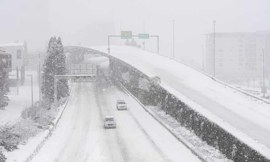 Cars drive along Interstate 705 in Tacoma, Washingtons state, on Saturday.
