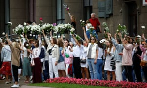 Thousands participated in peaceful protests in Minsk on Thursday, including many carrying flowers.