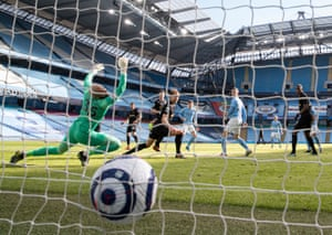 John Stones of Manchester City scores to make it 2-1.