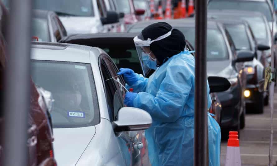 A nurse takes a swab sample at a drive-through coronavirus disease test site at the University of Texas El Paso in El Paso, Texas, this week.