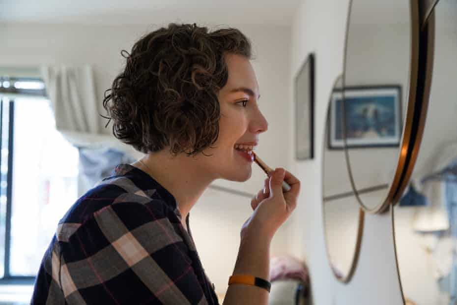 Emily Holden, the environment reporter for The Guardian US, puts on makeup at her apartment in Washington, DC.