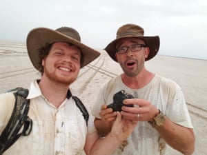 One of the researchers, Robert Howie, left, and Phil Bland with the 1.7kg meteorite dug from a hole in Lake Eyre in South Australia on New Year's Eve.