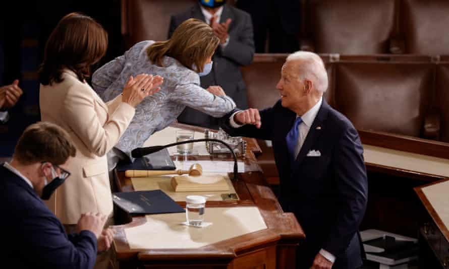 Biden elbow-bumps Pelosi after the speech.