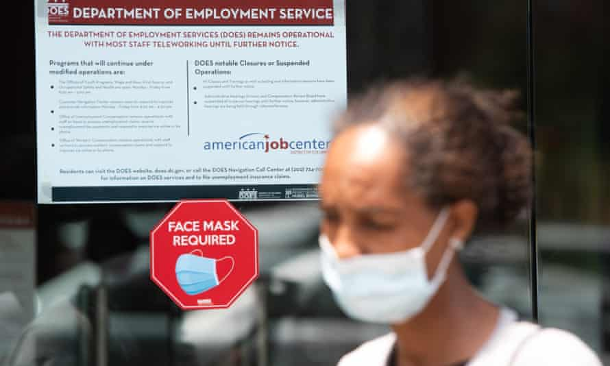A woman outside an unemployment office in Washington. Hanging in the balance of these 11th-hour negotiations are the financial livelihoods of 30 million unemployed Americans and their families.