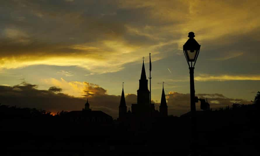 cathedral and lamp silhouetted by sunset