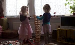 Children building toy blocks