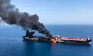 Smoke billowing from Norwegian-owned Front Altair tanker, said to have been attacked in the waters of the Gulf of Oman