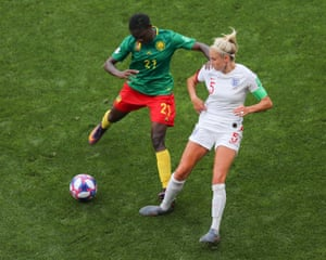 Alexandra Takounda leaves her mark on the England captain Steph Houghton late into the game.