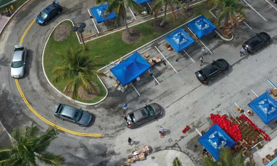 An aerial view of vehicles passing through as they receive food from a food bank in Sunrise, Florida, on 6 April.