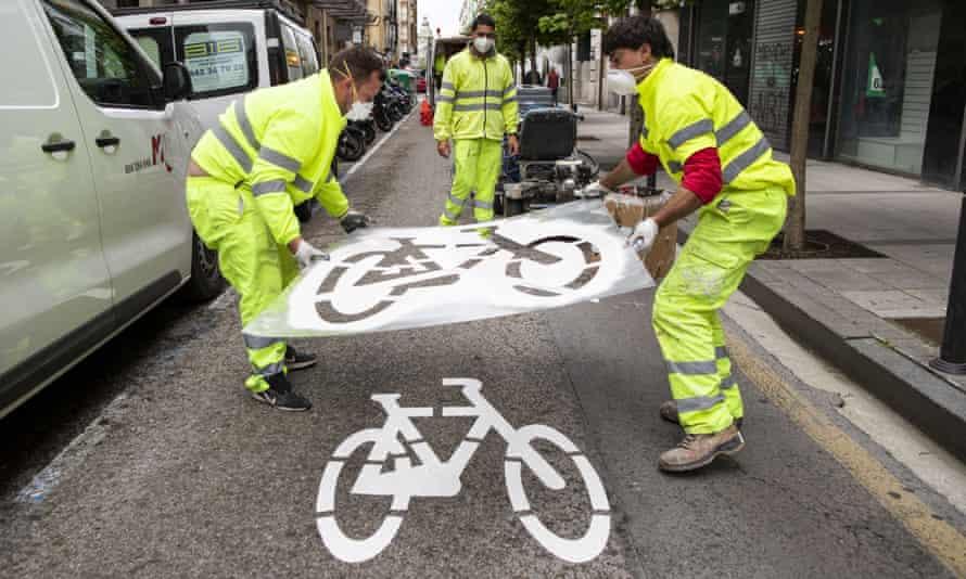 Workers create a bike lane in Cantabria, Spain.