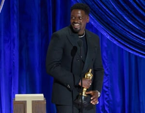 … and a cheeky grin after ending his acceptance speech on a joke at his parents' expense