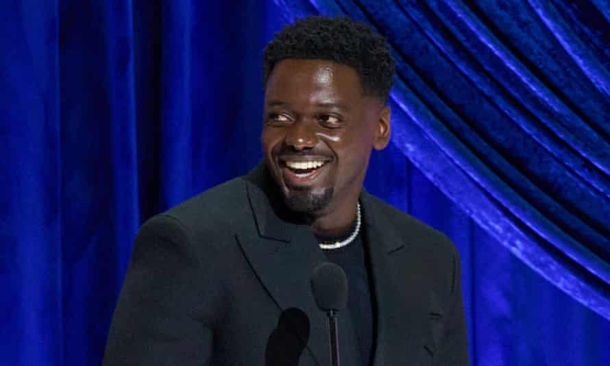 Daniel Kaluuya accepts the best supporting actor Oscar.