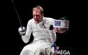 An overjoyed Piers Gilliver of Great Britain celebrates after winning the Men's Épée Individual Category A Gold Medal against Maxim Shaburov of Team RPC.