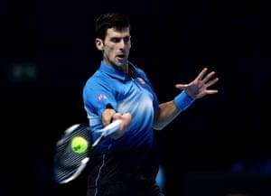Djokovic returns.