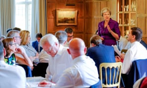 May speaks to members of her cabinet at Chequers in July 2018