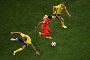England's Jesse Lingard dribbles past Sweden's Andreas Granqvist, left, and Sebastian Larsson.