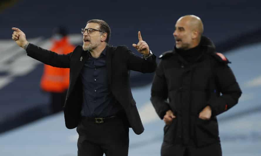 Slaven Bilic (left) was dismissed by West Bromwich Albion despite a creditable 1-1 draw against Manchester City on Tuesday night.