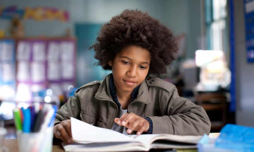 Black boy with afro in classroom