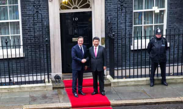 The red carpet is rolled out as David Cameron greets Chinese President Xi Jinping at Downing Street in London.