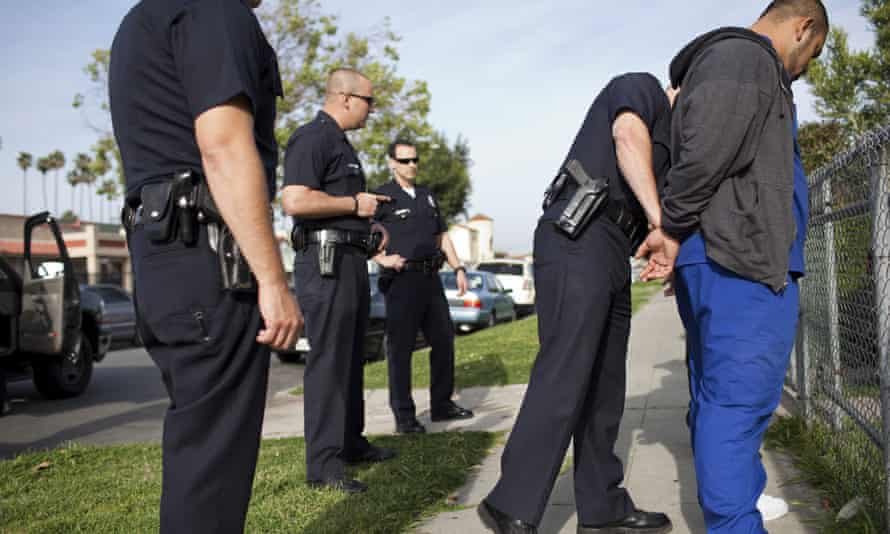 Police officers arrest a man in Los Angeles.