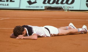 John McEnroe lies on the clay during his 1984 French Open final defeat to Ivan Lendl.
