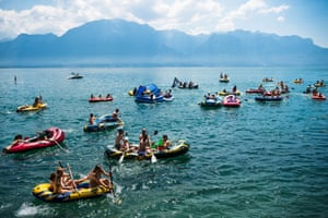 Young people participate in a inflatable boats race 'Pneumatik Race' along the Lake Geneva