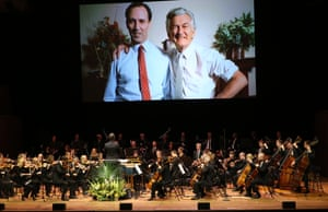 An old image of Paul Keating with Bob Hawke is projected during memorial service.