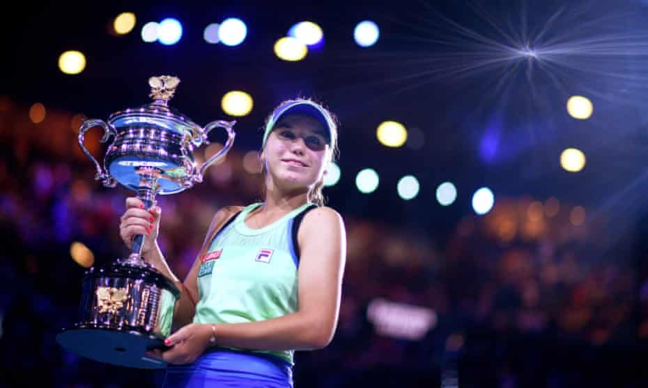 Sofia Kenin poses with the Australian Open trophy after battling back from a set down to win her first grand slam title.